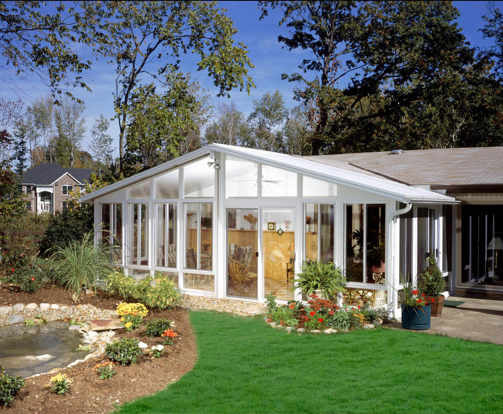 A sunroom with floor to ceiling glass windows can overlook your yard and garden