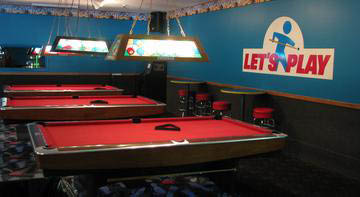 The billiards tables located in Logan Lanes