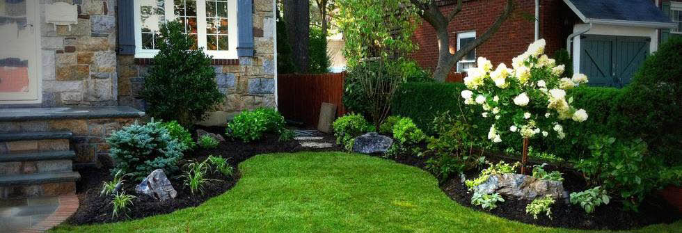 Picture of Louisville Mulch & Tree Care Inc home with landscaping