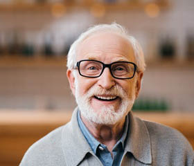 Elderly man smiling with confidence because of his dentures provided by Love My Smile Center in Auburn & Marysville, WA - Auburn denture offices near me - Marysville denture offices near me - denture coupons near me