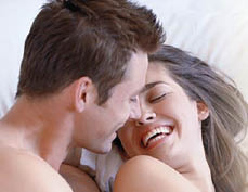 Happy couple in bed - Love Zone - Marysville, WA - Everett, WA - sexy lingerie - sex toys - sex games