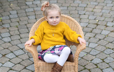 little girl sitting in a chair