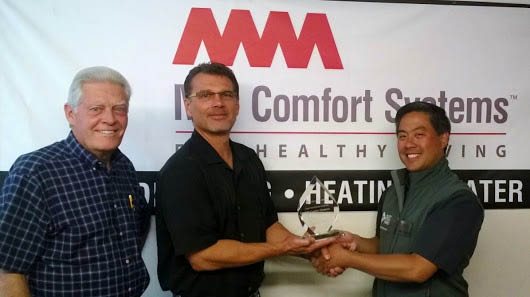 MM Comfort Systems receiving an award from Puget Sound Energy - heating & ac contractors in Redmond, Washington