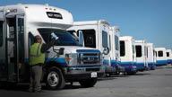 row of semi-trucks; truck driving jobs; truck drivers wanted; MV Transportation in Chicago, IL