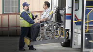 wheelchair bound person getting transported; Paratransit drivers offer assistance as needed in Chicago