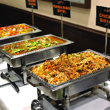Fresh Indian food dishes on the buffet
