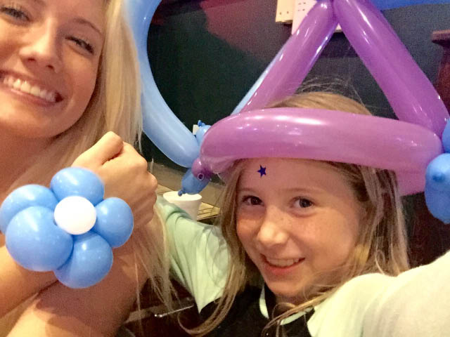 photo of kids with ballon hat at Mallie's Sports Grill in Southgate, MI