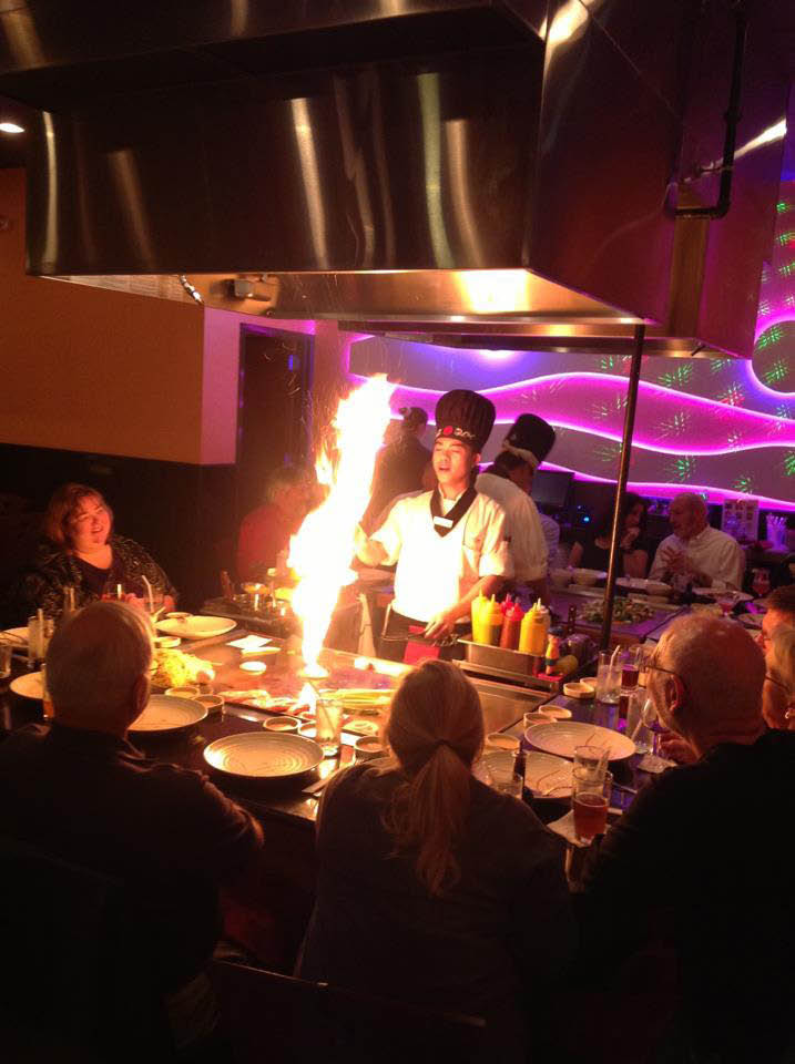 Chef flaming meal Teppanyaki Style