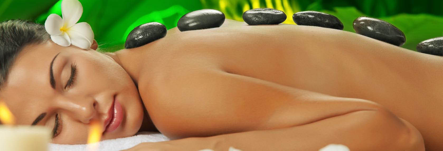 Woman relaxing with hot stone massage