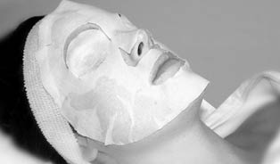 woman receiving facial in South Florida massage spa