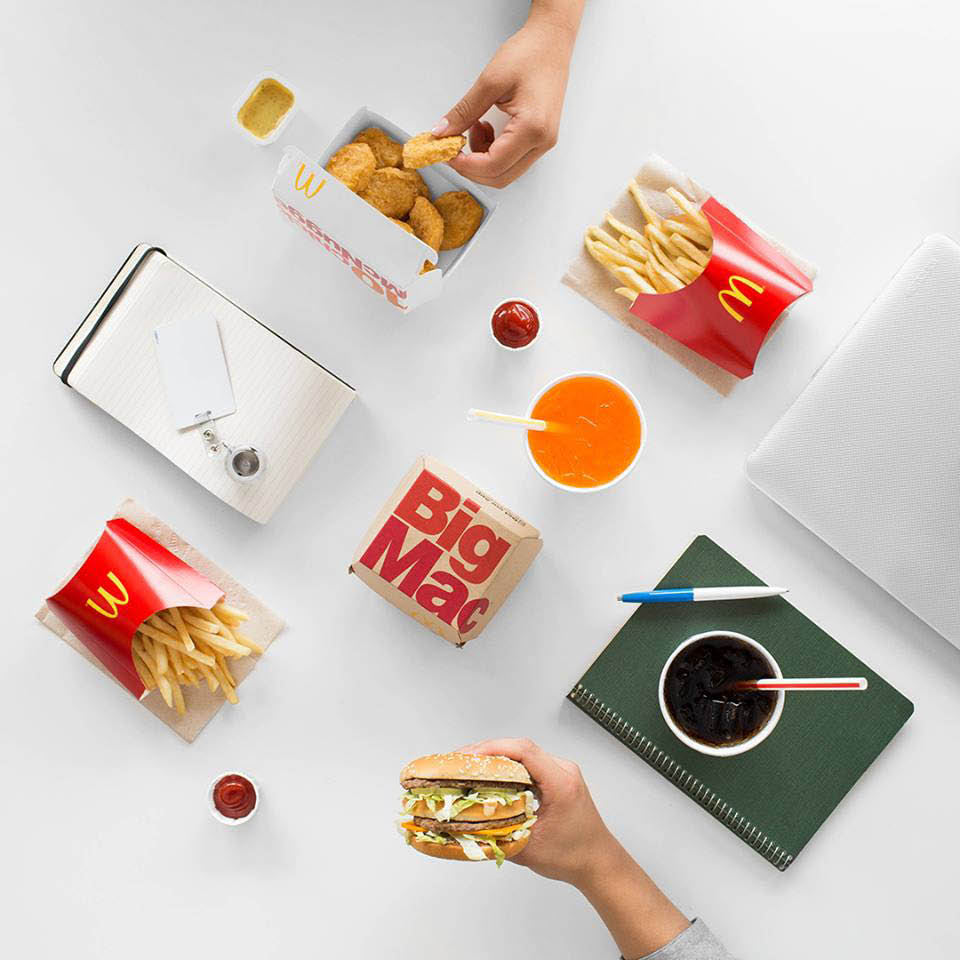 McDonald's Big Mac & chicken nuggets meals on a table with ketchup and mustard