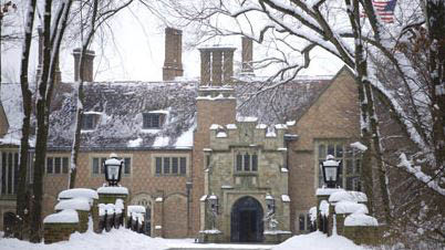 photo of the exterior of Meadow Brook Hall in Rochester, MI with snow