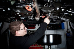 Mechanic, Auto Repair, Mechanic Holding Wrench, Scott's Tire Service in Chambersburg