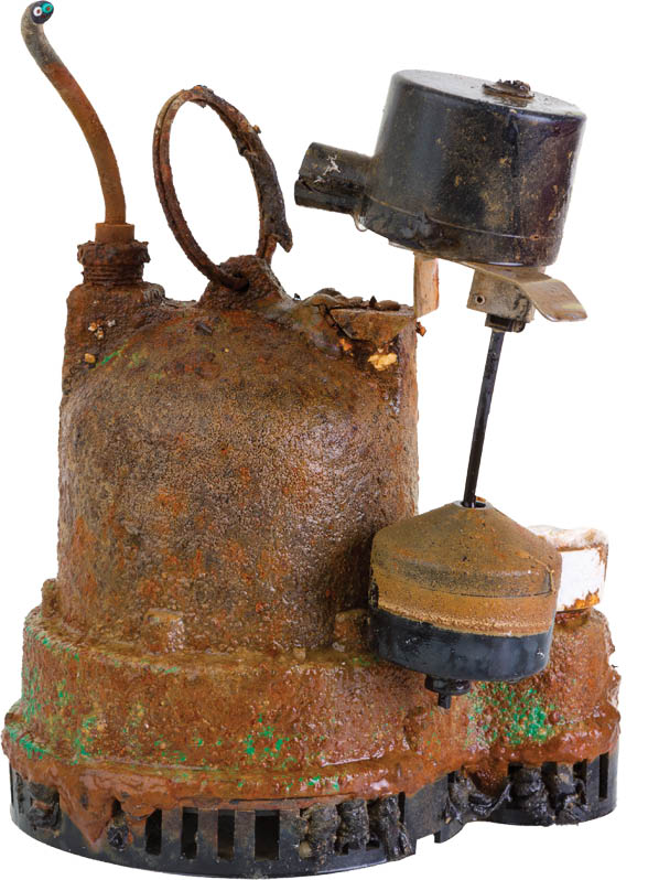 photo of old rusty sump pump to be replaced by The Meridian Company in East Lansing, MI