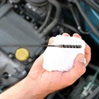 A Merlin oil change service saves you money with an oil change coupon
