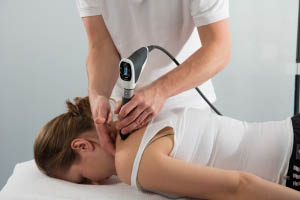 Pressure Wave Therapy on the neck and shoulders - Metcalf Chiropractic Health & Laser Center in Duvall, WA - Duvall chiropractors near me - chiropractors in Duvall, WA - relieve neck pain - relieve shoulder pain