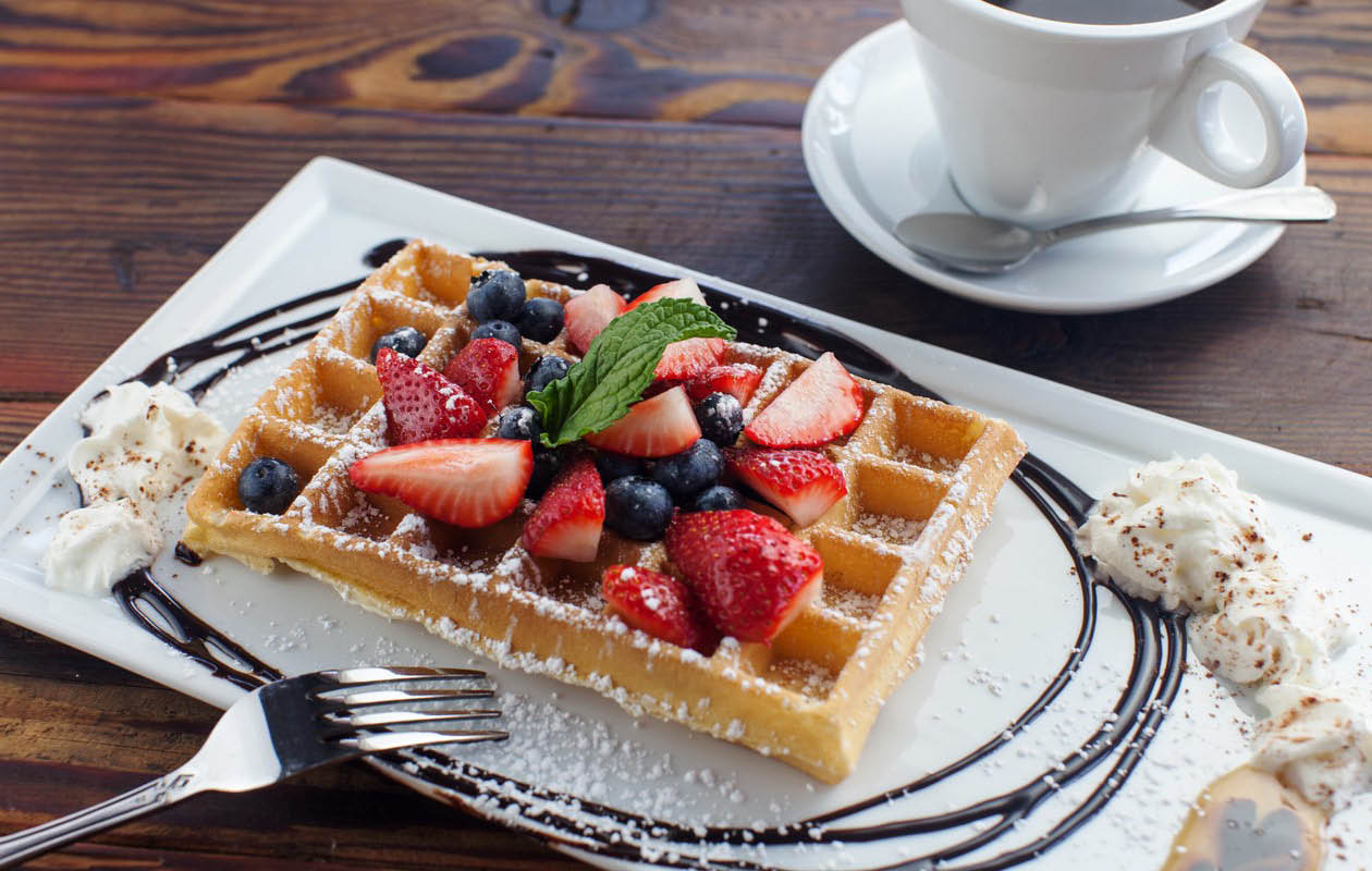 Waffles and berries on Met Her At A Bar menu