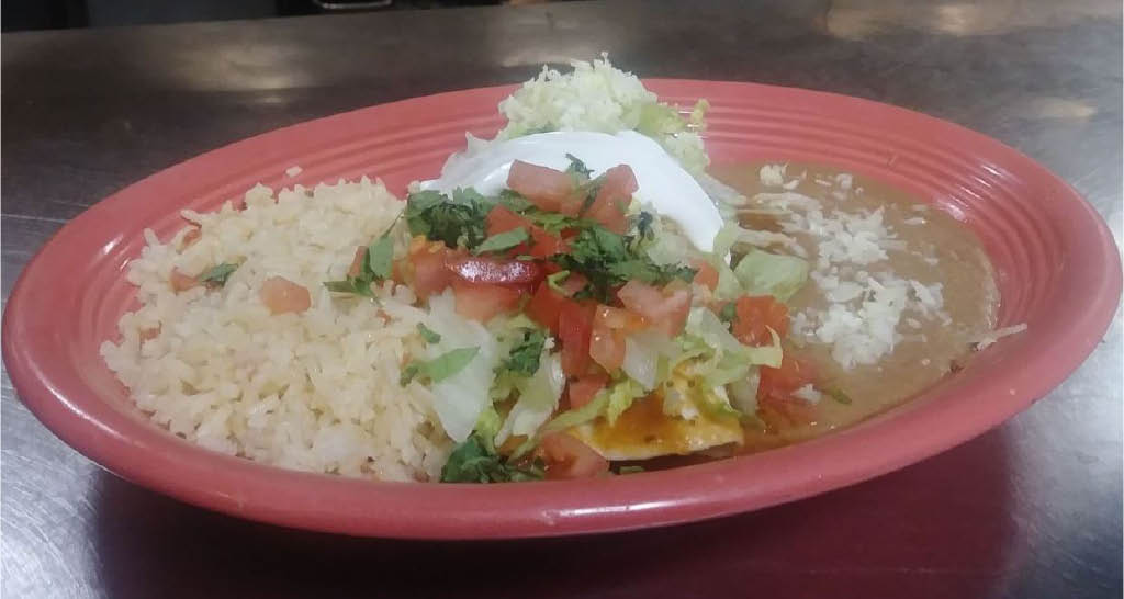 Mexican rice with tomato salsa, guacamole and refried beans