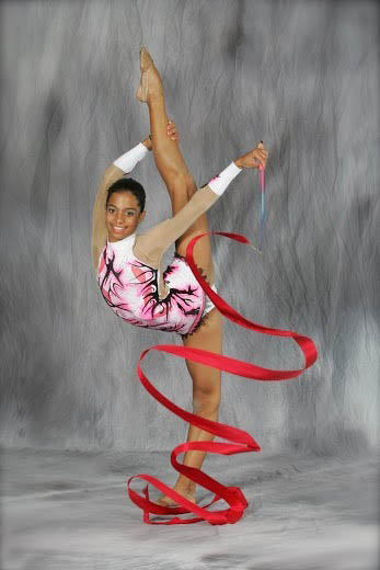 young female dancer with red ribbon streamer; Miami Dance Academy; youth dance instruction; ballet