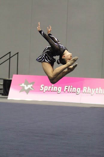 dance gymnastics; female gymnast turning in air; gymnastic competitions; youth lessons Miami