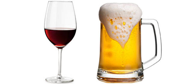 Glass of red wine and mug of beer.