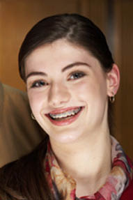 photo of student with braces from Mid-Michigan Dental Group in Flint, MI