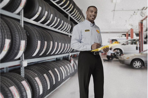 Midas technician offers brand name tires for your car or truck