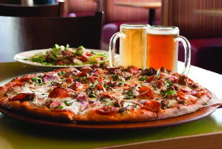 specialty pizza, salad and beer