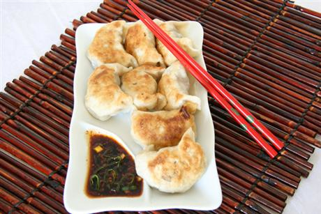 Japanese pan fried dumplings with dipping sauce