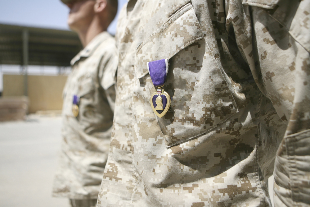 Military personnel wearing a purple heart