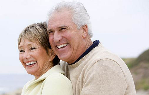 Retired man and woman in later years hugging and smiling in Missouri.
