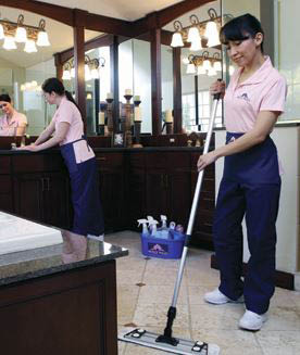 photo of Molly Maid employee mopping the floor