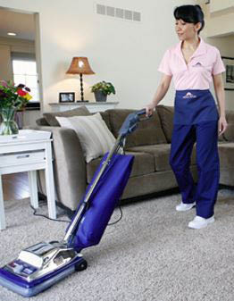 photo of Molly Maid employee vacuuming