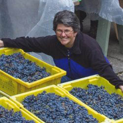Dawne and the grapes at Moose Canyon Winery in Edgewood, Washington - wineries near me - wine tasting near me