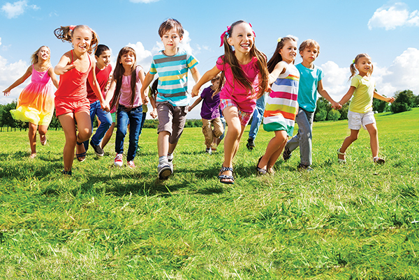children running in a field free of ticks