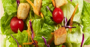 Crispy green salad and plenty of veggie and cheese choices at our salad bar