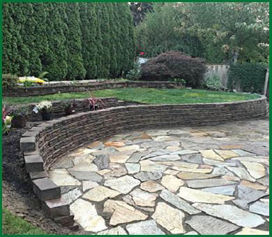 Gorgeous landscaping around rockery done by Mr. Ho's Gardening & Landscaping - Des Moines, WA