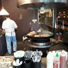 Fresh meats and vegetables prepared on a sizzling grill at Mongolian Grill in Mukilteo, WA and Woodinville, WA