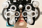 Optometrist with eye exam equipment; My Eye Dr.