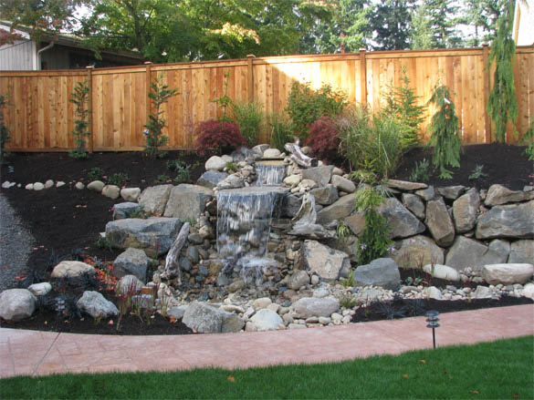 Gorgeous rock waterfall installed in the back yard by Natural Design Landscaping - Fall City, WA - beautiful rock water feature