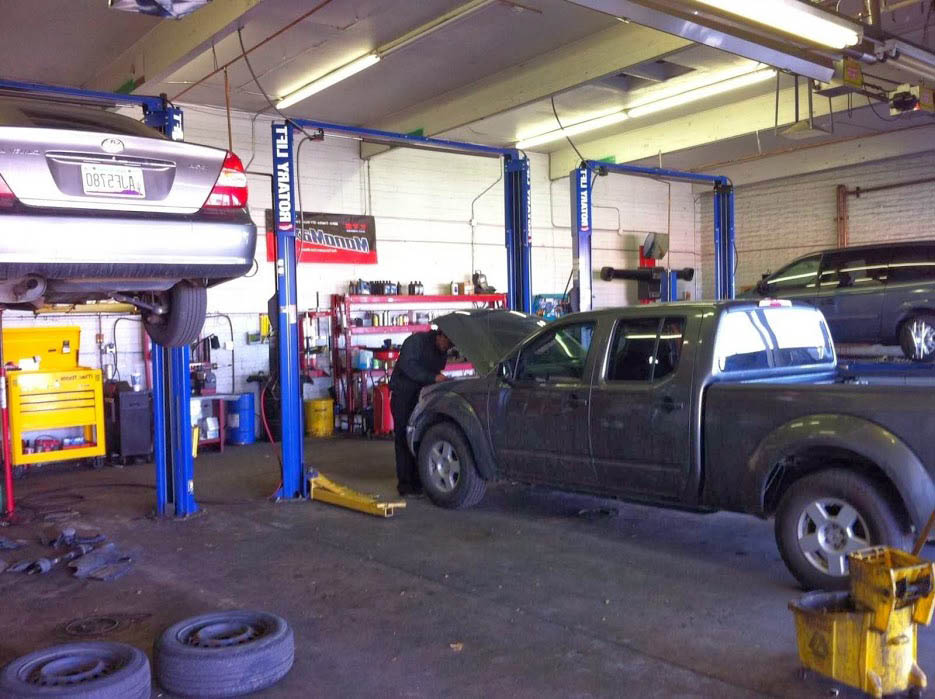 truck in auto service bay; Network Automotive Service Center; wheel alignment Mesa, Arizona