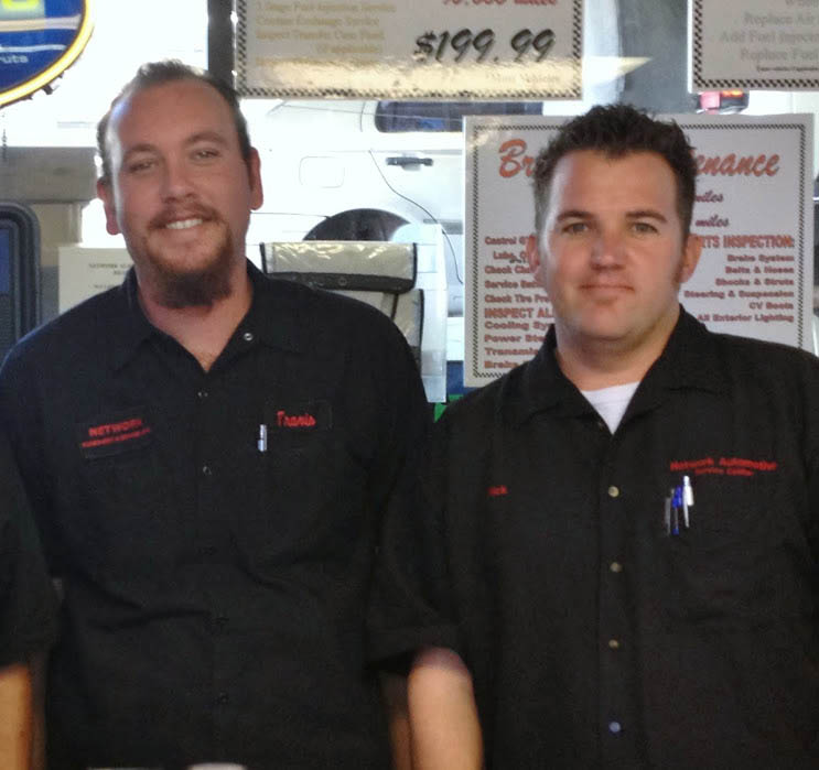 Two auto technicians from Network Automotive Service Centers
