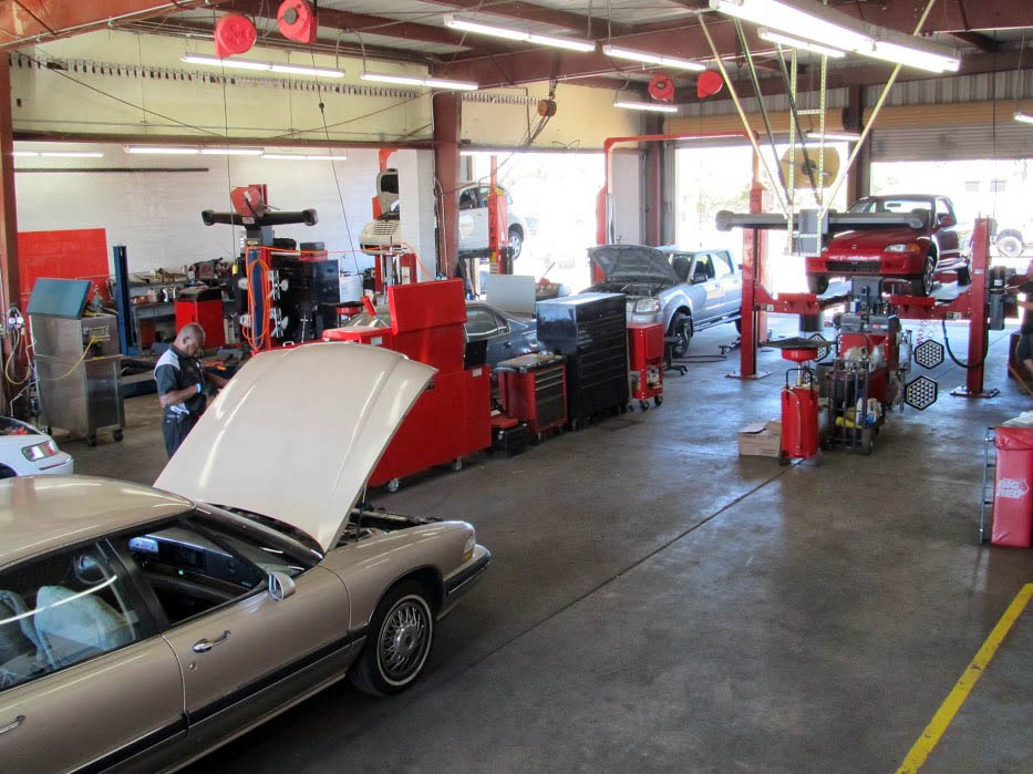 tan car in auto service bay; Network Automotive Service Center; oil change; Wheel alignment coupon; Prescott, Arizona