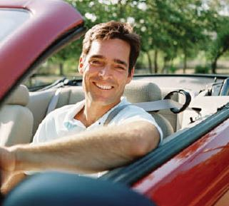 photo of smiling man in car, satisfied with service from Nick's Auto & Tire in Plymouth, MI