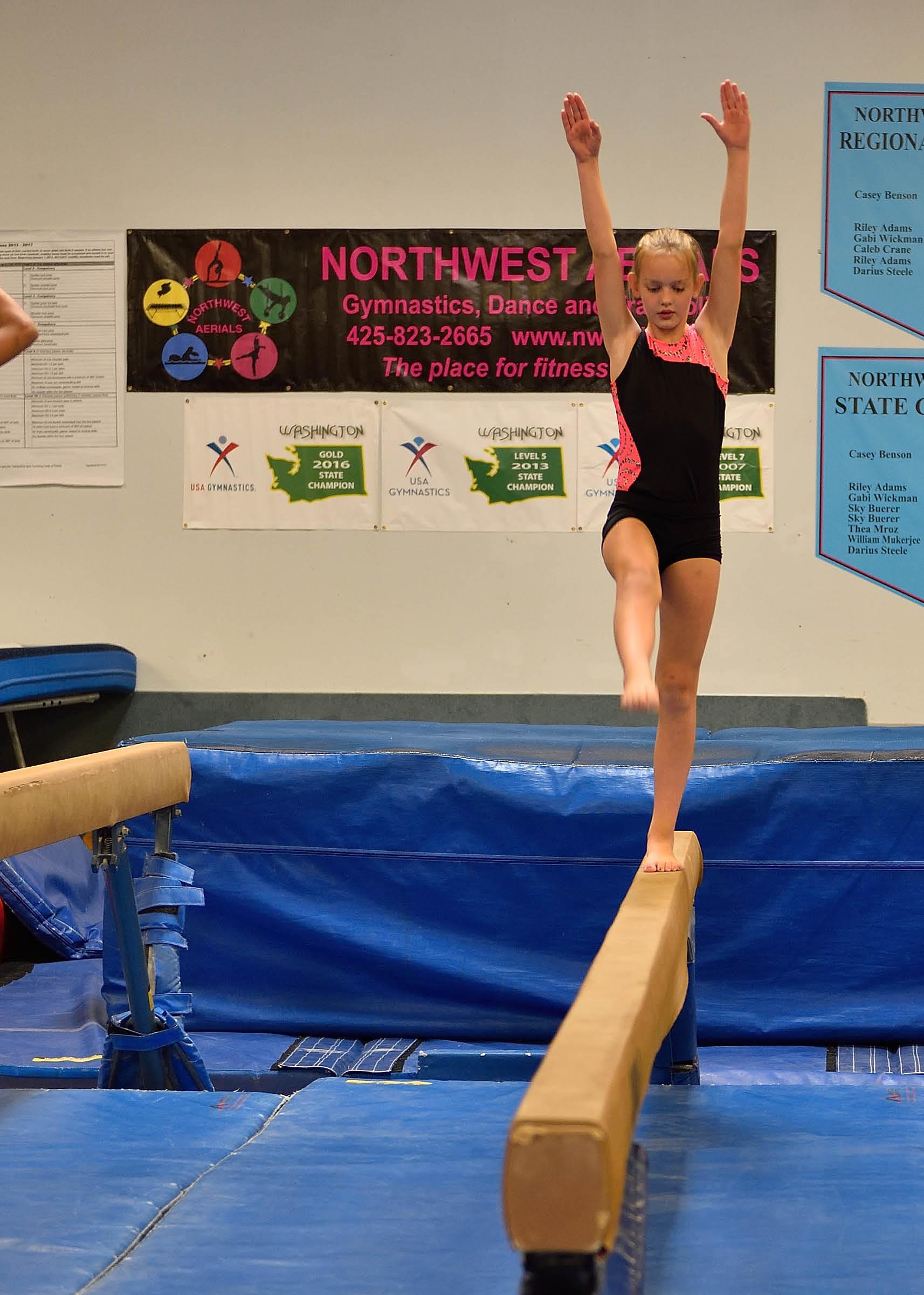 Northwest Aerials - Kirkland, WA - girl on balance beam - gymnastics training - dance - trampoline