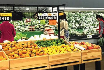 Large produce department offers jackfruit and other exotic fruits and vegetables in Roy, Utah.