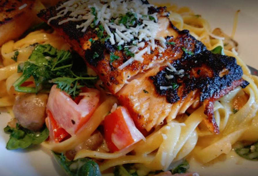 Salmon fettuccine and other mouth-watering pasta dishes served at Olympia Oyster House in Olympia, Washington - seafood restaurants in Olympia - seafood near me - fine dining coupons near me