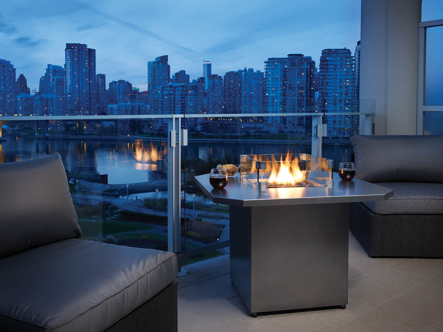 Gorgeous skyline view from a deck with a beautiful table wood stove from Olympic Stove and Spa in Shelton, WA