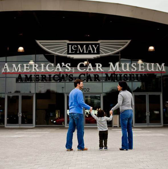 A family standing outside LeMay America's Car Musuem in Tacoma, WA - Tacoma museums - museums in Tacoma, WA