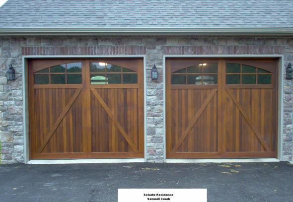 Dual wooden garage doors from the Overhead Door Company
